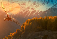 czarny smok lecący nad doliną